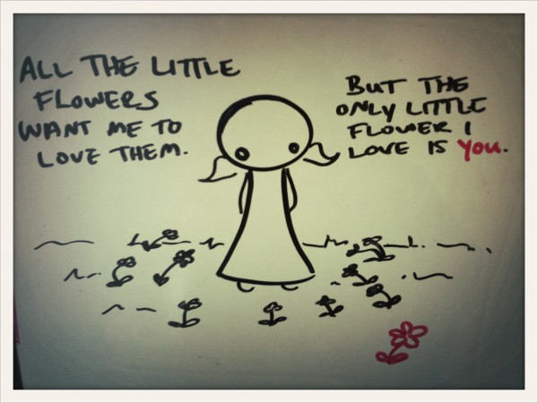 all the little flowers want me to love them, but the only little flower i love is you.