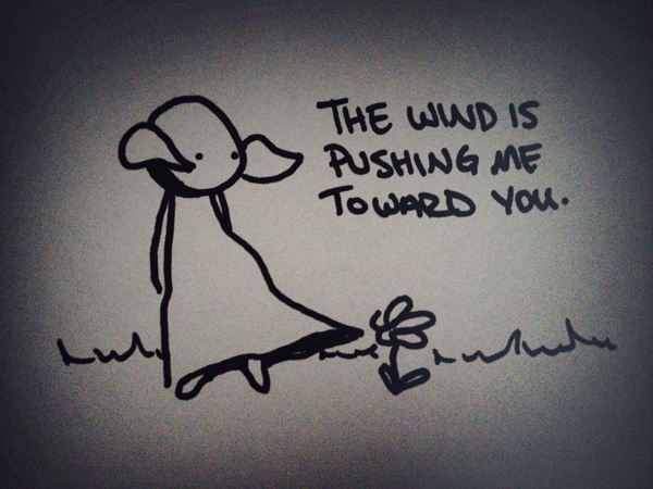 the wind is pushing me toward you.